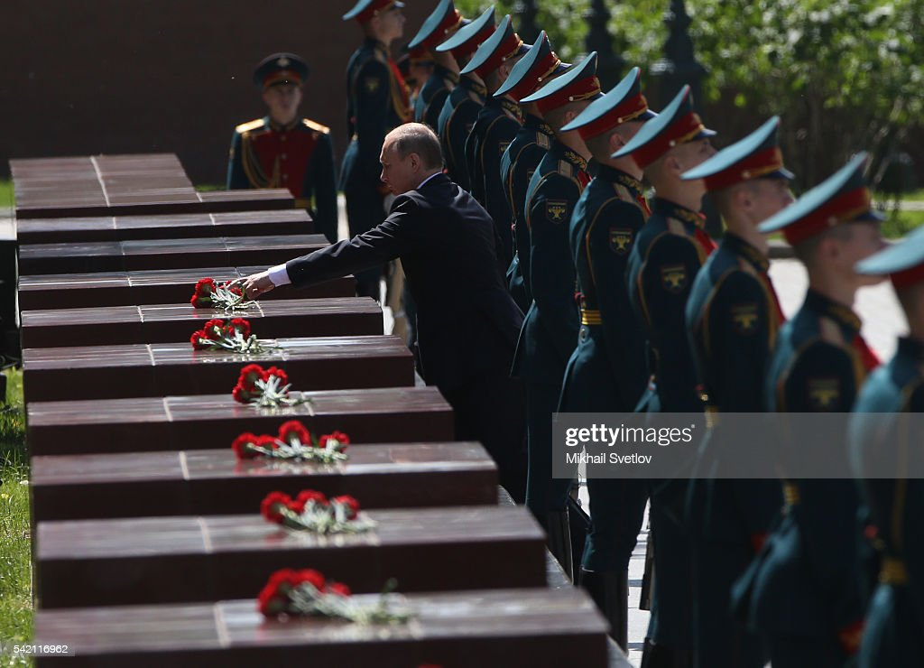 Russian President Vladimir Putin lays a wreath at the Unknown Soldier's Tomb on June 22 2016 in Moscow Russia Russia is marking the 75th anniversary...