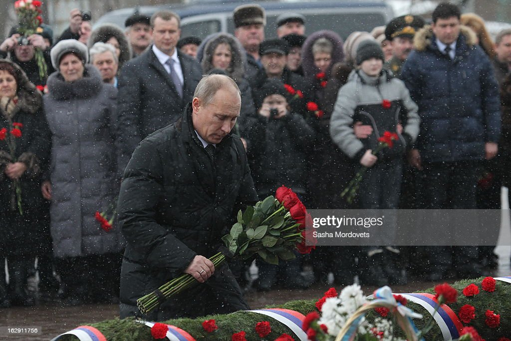 Russian President Vladimir Putin lays flowers during a memorial service on March 1, 2013 in Pskov, Russia. President Putin visited a memorial in western Russia to honour 84 soldiers killed in Chechnya.