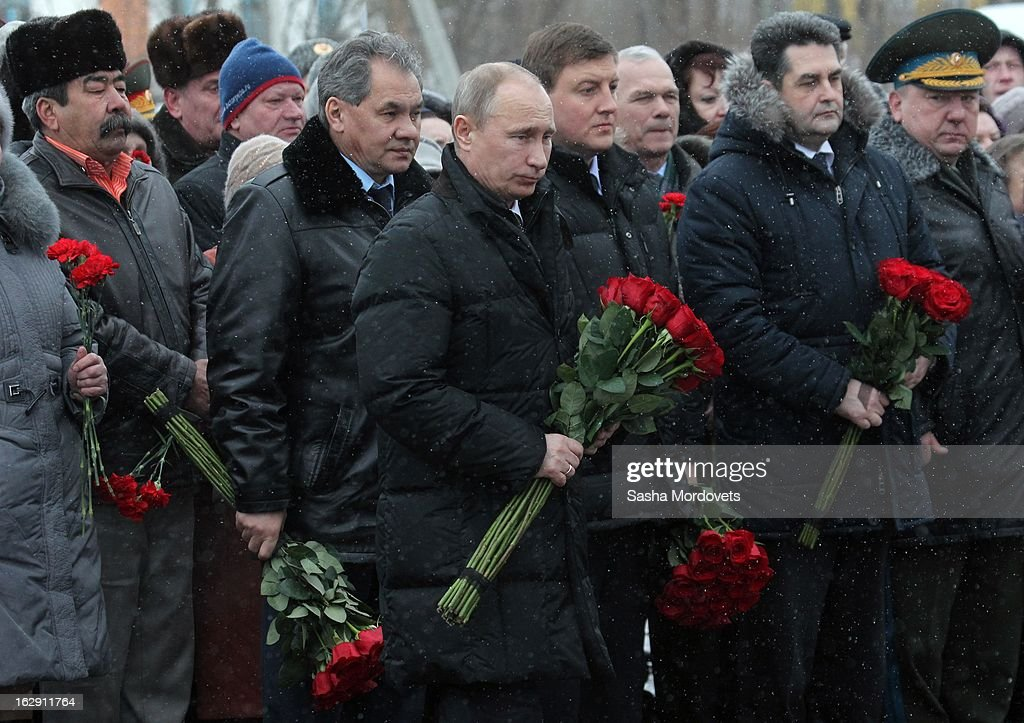 Russian President <a gi-track='captionPersonalityLinkClicked' href=/galleries/search?phrase=Vladimir+Putin&family=editorial&specificpeople=154896 ng-click='$event.stopPropagation()'>Vladimir Putin</a> lays flowers during a memorial service on March 1, 2013 in Pskov, Russia. President Putin visited a memorial in western Russia to honour 84 soldiers killed in Chechnya.