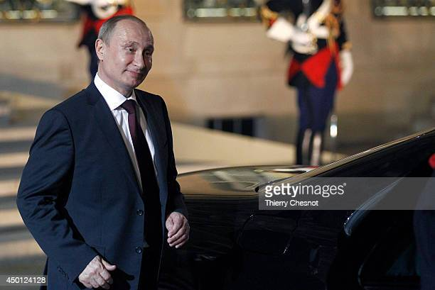 Russian President Vladimir Putin leaves the Elysee Palace after a meeting and a dinner with French President Francois Hollande on June 5 in Paris...
