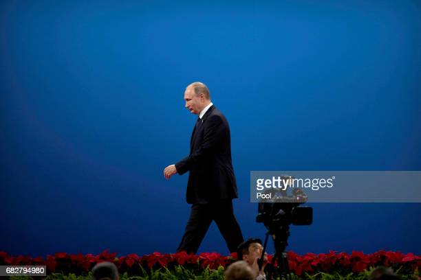 Russian President Vladimir Putin leaves the stage after speaking during the opening ceremony of the Belt and Road Forum at the China National...