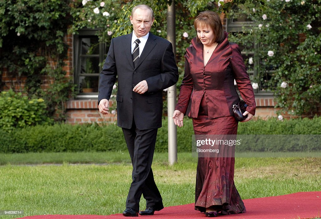 Russian President <a gi-track='captionPersonalityLinkClicked' href=/galleries/search?phrase=Vladimir+Putin&family=editorial&specificpeople=154896 ng-click='$event.stopPropagation()'>Vladimir Putin</a>, left, arrives with his wife Lyudmila Putin for the G-8 dinner at Gut Hohen Luckow near Bad Doberan, Germany, Wednesday, June 6, 2007.