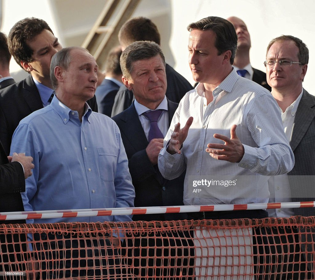 Russian President Vladimir Putin (L) listens as Britain's Prime Minister David Cameron (R) speaks during a visit to the 2014 Winter Olympic venues after their meeting at the Bocharov Ruchei state residence in Sochi on May 10, 2013. Britain and Russia on May 10 sought to forge a joint approach to the crisis in Syria, as US Secretary of State John Kerry said there was 'strong evidence' Damascus had used chemical weapons against rebels.