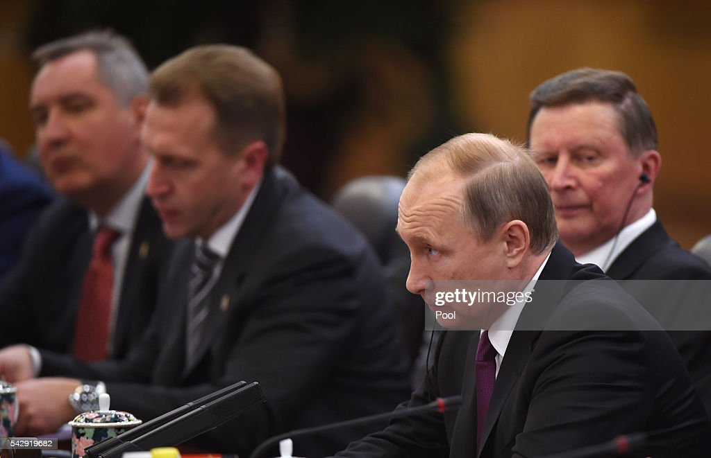 Russian President Vladimir Putin listens as Chinese President Xi Jinping speaks during a meeting in Beijing's Great Hall of the People on June 25, 2016 in Beijing, China. Russian President Vladimir Putin is in China to discuss more economic and military cooperation between the two countries.