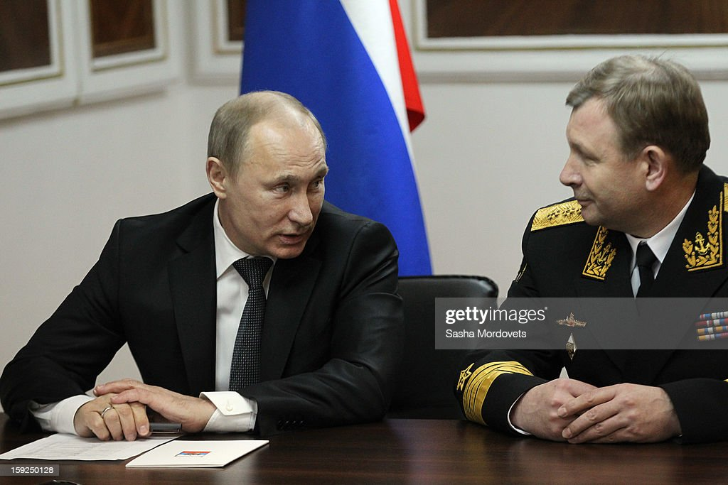 Russian President Vladimir Putin (L) listens to Adm. Viktor Chirkov as he visits the heavy nuclear-powered missile cruiser Pyotr Veliky at the Russian Northern Fleet's base January 10, 2013 in Severomorsk, Russia. Putin awarded the crew of the Pyotr Veliky the Nakhimov order.