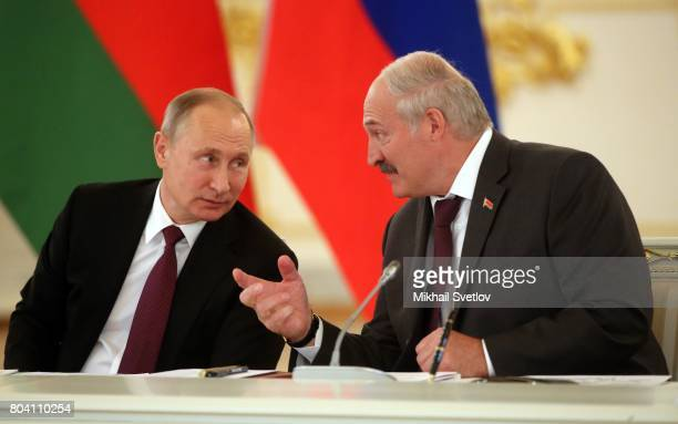 Russian President Vladimir Putin listens to Belarussian President Alexander Lukashenko during the Supreme State Council of Russia and Belarus at the...