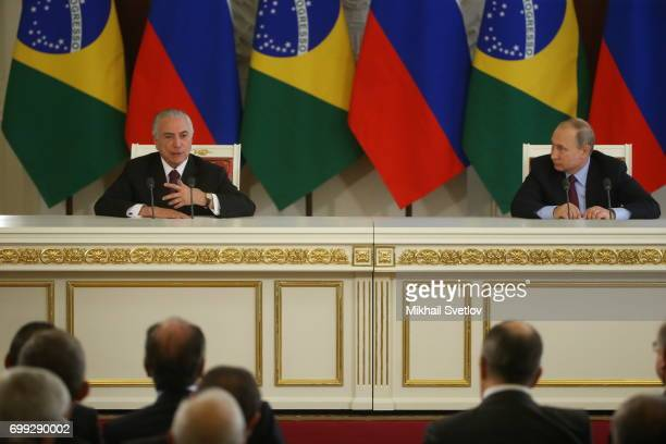 Russian President Vladimir Putin listens to Brazilian President Michel Temer during their meeting at the Grand Kremlin Palace in Moscow Russia...