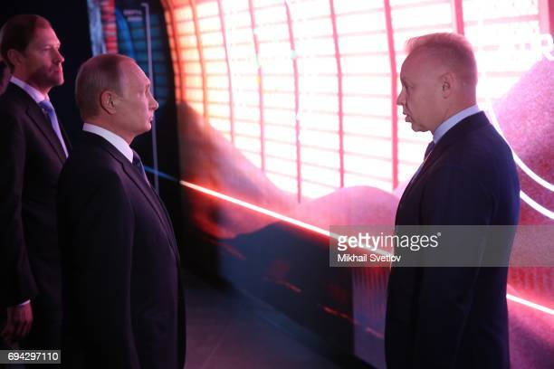 Russian President Vladimir Putin listens to CEO of Uralkali Dmitry Mazepin as Trade and Energy Minister Denis Manturov looks on while visiting the...