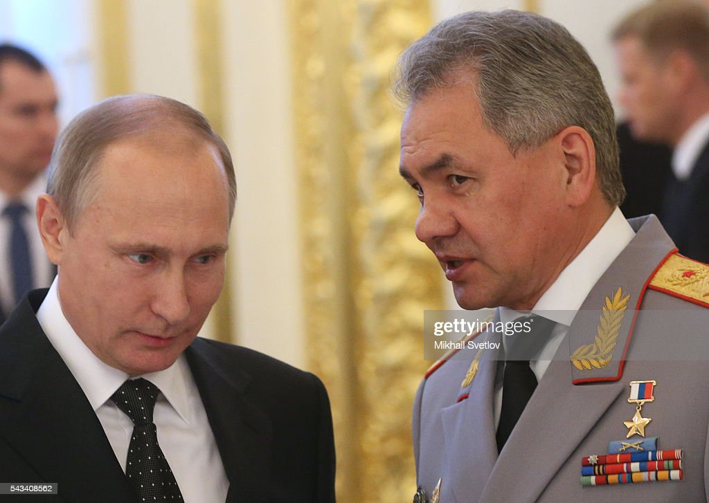 Russian President Vladimir Putin (L) listens to Defence Minister Sergei Shoigu (R) during the reception for graduates of military academies and universtities at the Grand Kremlin Palace on June 28, 2016 in Moscow, Russia.