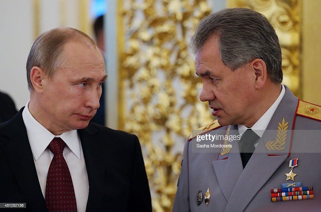 Russian President <a gi-track='captionPersonalityLinkClicked' href=/galleries/search?phrase=Vladimir+Putin&family=editorial&specificpeople=154896 ng-click='$event.stopPropagation()'>Vladimir Putin</a> (L) listens to Defence Miniter Sergei Shoigu (R) during a reception for military academy graduates at the Grand Kremlin Palace on June 26, 2014 in Moscow, Russia.