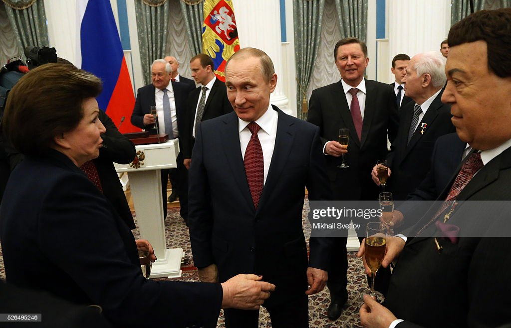 Russian President <a gi-track='captionPersonalityLinkClicked' href=/galleries/search?phrase=Vladimir+Putin&family=editorial&specificpeople=154896 ng-click='$event.stopPropagation()'>Vladimir Putin</a> (C) listens to First Female Cosmonaut <a gi-track='captionPersonalityLinkClicked' href=/galleries/search?phrase=Valentina+Tereshkova&family=editorial&specificpeople=906013 ng-click='$event.stopPropagation()'>Valentina Tereshkova</a> (L) as Soviet songs pop singer, State Duma Deputy Joseph Kobzon (R) looks and during the awarding ceremony at the Kremlin April, 30, 2016 in Moscow, Russia. Putin presented Hero of Labour medals to five winners. The awards were given to Russians who made a considerable contribution to the country's social and economic development, including development of culture, education, industry and agriculture.