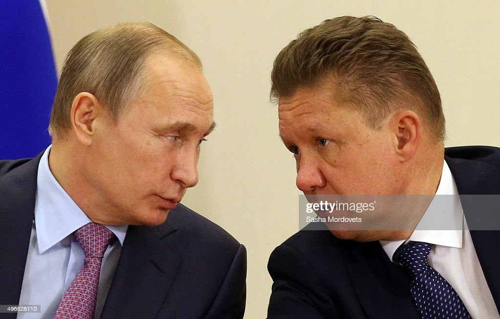 Russian President Vladimir Putin (L) listens to Gazprom CEO <a gi-track='captionPersonalityLinkClicked' href=/galleries/search?phrase=Alexei+Miller&family=editorial&specificpeople=713081 ng-click='$event.stopPropagation()'>Alexei Miller</a> (R) during a Russian-Kuwait meeting in Bocharov Ruchey State Residence on November 10, 2015 in Sochi, Russia. Emir of Kuwait is having a state visit to Russia.