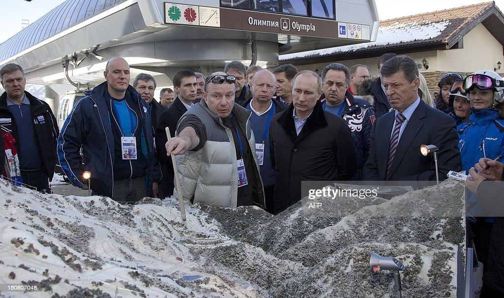 Russian President Vladimir Putin (3rd R) listens to Interros Investment Company President Vladimir Potanin ((2nd L) during a visit to the Rosa Khutor Alpine Centre, one of the Sochi 2014 Winter Olympic venues, near the Black Sea city of Sochi, on February 6, 2013 with the head of the Sochi 2014 Olympic preparatory commission Deputy Prime Minister Dmitry Kozak (2nd R) and Sochi 2014 CEO Dmitry Chernyshenko (2nd L) accompanying Putin.