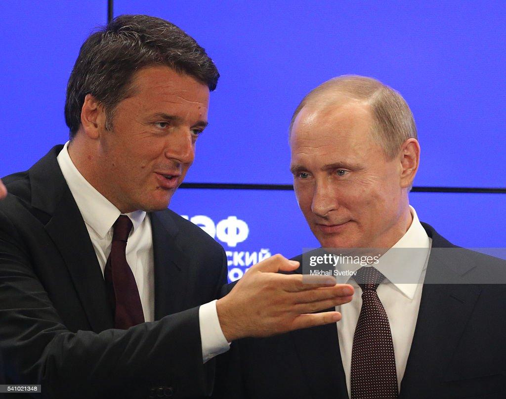 Russian President Vladimir Putin (R) listens to Italian Prime Minister Matteo Renzi during the Saint Petersburg International Economic Forum SPIEF2016 on June 17, 2016 in Saint Petersburg, Russia.