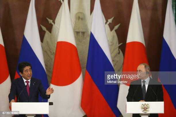Russian President Vladimir Putin listens to Japanese Prime Minister Shinzo Abe during their talks at the Grand Kremlin Palace on April 27 2017 in...
