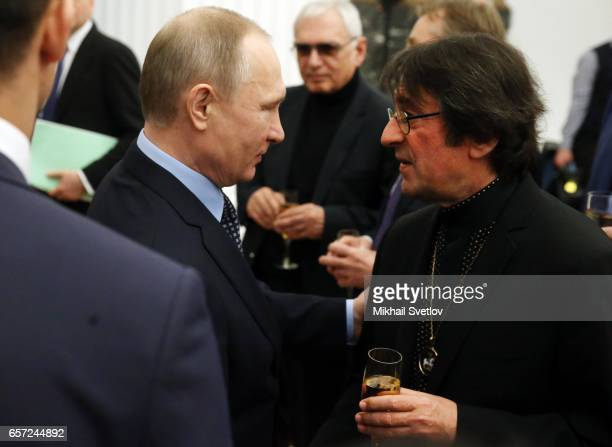 Russian President Vladimir Putin listens to musician Yuri Bashmet during the awards ceremony at the Kremlim on March 2017 in Moscow Russia has...