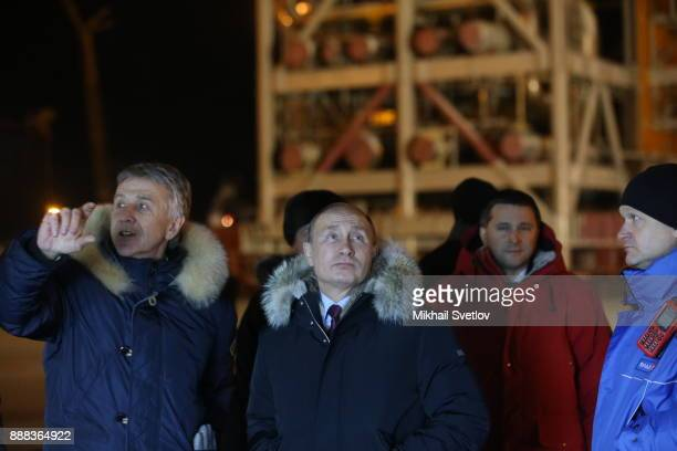 Russian President Vladimir Putin listens to Novatek CEO Leonid Michelson while visiting the LNG plant in Sabetta sea port at Yamal peninsula in...