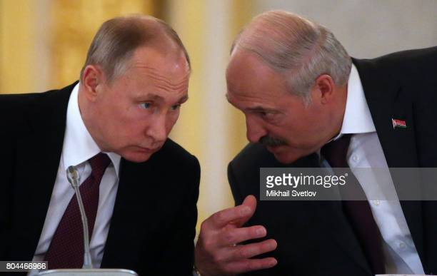 Russian President Vladimir Putin listens to President of Belarus Alexander Lukashenko during the Supreme State Council of Russia and Belarus at the...