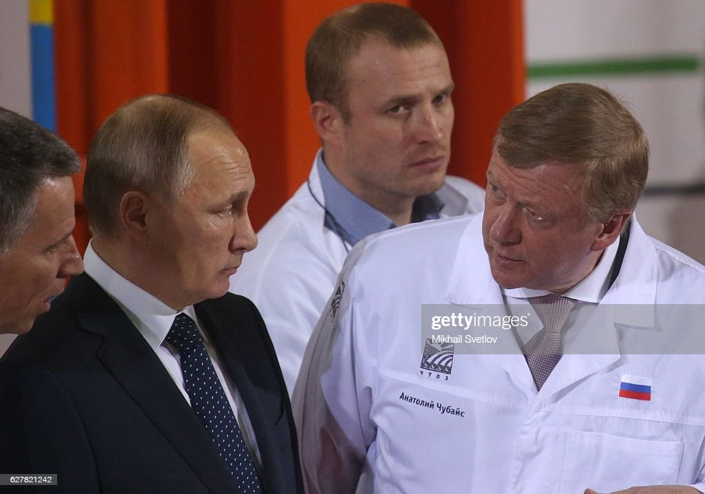 Russian President Vladimir Putin (L) listens to Rosnano Chairman Anatoly Chubais while visiting the Chelyabinsk Pipe-Rolling Plant, in Chelyabinsk, Russia, December 5, 2016.