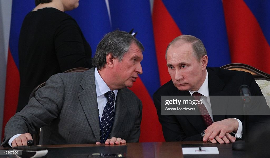 Russian President Vladimir Putin (R) listens to Rosneft's President <a gi-track='captionPersonalityLinkClicked' href=/galleries/search?phrase=Igor+Sechin&family=editorial&specificpeople=756791 ng-click='$event.stopPropagation()'>Igor Sechin</a> during Russian-Armenian talks December 2, 2013 in Yerevan, Armenia. Putin is in a one-day state visit to Armenia.