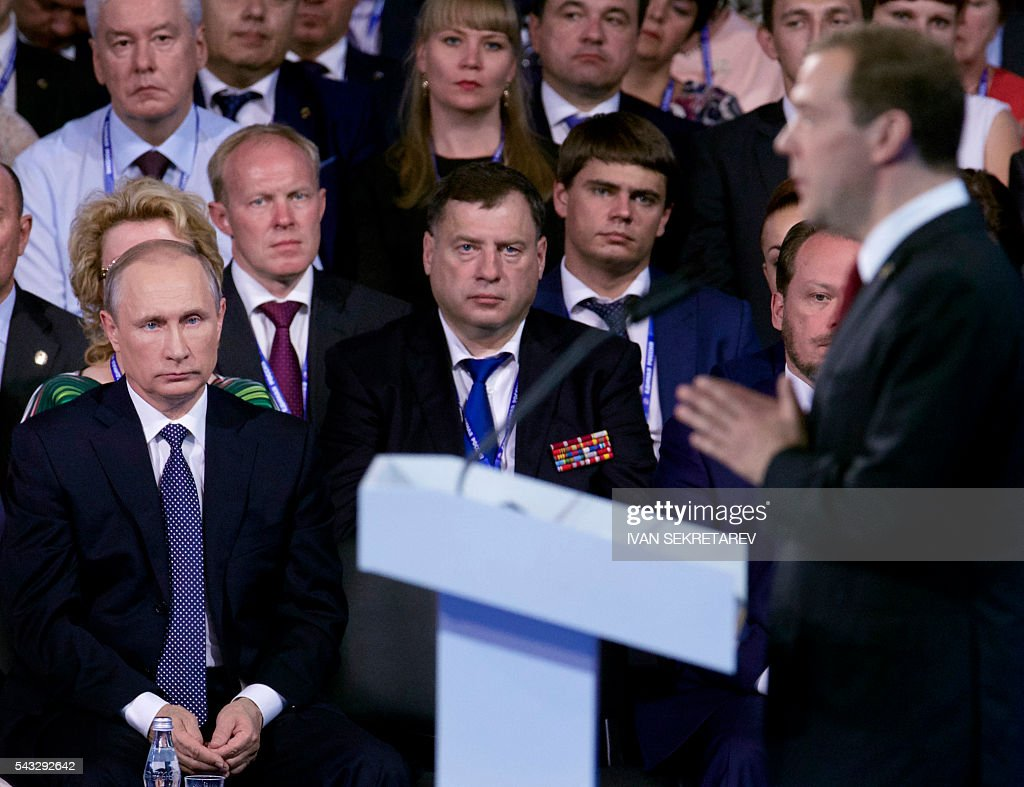 Russian President Vladimir Putin (L) listens to the speech of Prime Minister Dmitry Medvedev (R), during the 15th Convention of the ruling party United Russia in Moscow on June 27, 2016, ahead of parliamentary elections in September. / AFP / POOL / Ivan Sekretarev