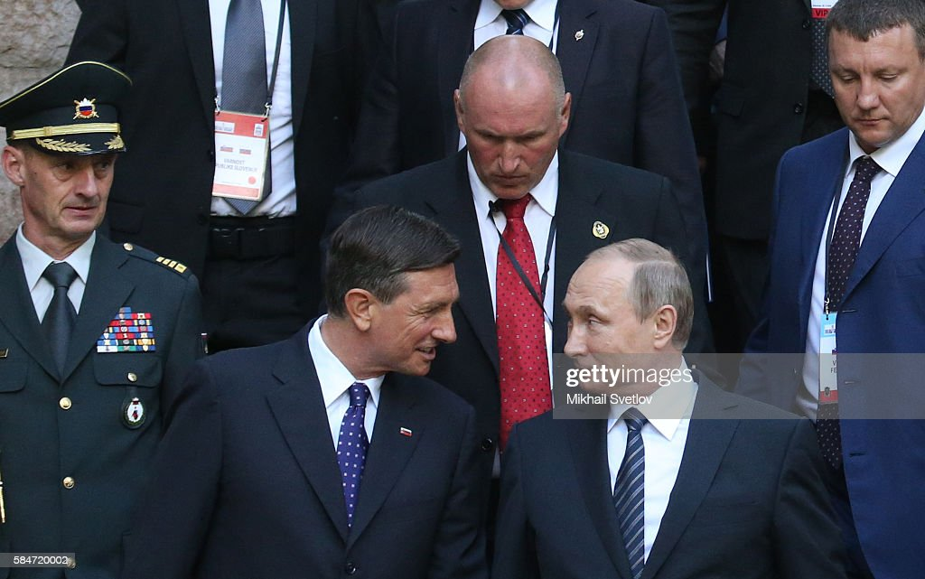 Russian President Vladimir Putin listern to Slovenian President Borut Pahor while seen visiting the the Russian Church marking its 100th jubelee...