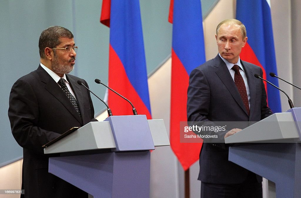 Russian President <a gi-track='captionPersonalityLinkClicked' href=/galleries/search?phrase=Vladimir+Putin&family=editorial&specificpeople=154896 ng-click='$event.stopPropagation()'>Vladimir Putin</a> (R) looks on as Egyptian President <a gi-track='captionPersonalityLinkClicked' href=/galleries/search?phrase=Mohamed+Morsi&family=editorial&specificpeople=7484676 ng-click='$event.stopPropagation()'>Mohamed Morsi</a> (L) speaks April 19, 2013 in Sochi, Russia. President Morsi is on a one-day visit to Russia. President Morsi is on a two-day visit to Russia and is expected to hold a mini-summit with Putin to promote bilateral ties, and attract investments to Egypt in the fields of energy, transport and engineering.