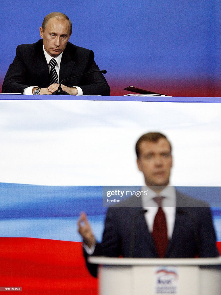 Russian President Vladimir Putin (L) looks on as First Deputy Prime Minister Dmitry Medvedev delivers a speech at the congress of the United Russia party on December 17, 2007 in Moscow, Russia. President Vladimir Putin has backed Medvedev as presidential candidate to replace him after he leaves office next year, Russian news agencies reported.
