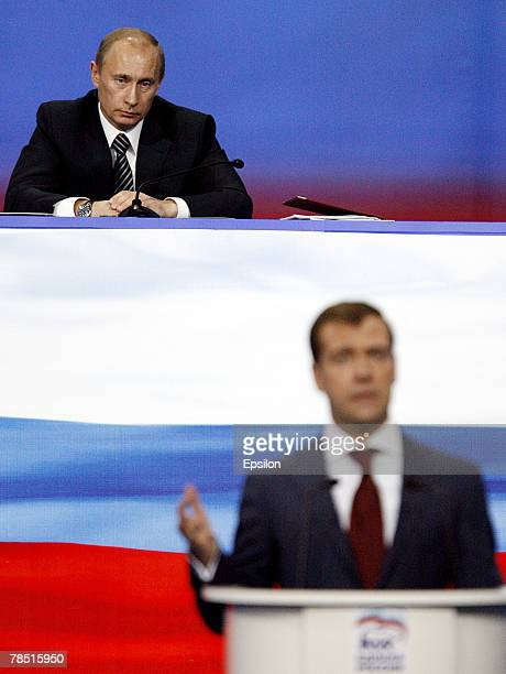 Russian President Vladimir Putin looks on as First Deputy Prime Minister Dmitry Medvedev delivers a speech at the congress of the United Russia party...