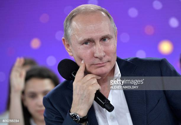 Russian President Vladimir Putin looks on as he attends the 'A Grownup Conversation with Vladimir Putin' TV show held at the Sirius educational...