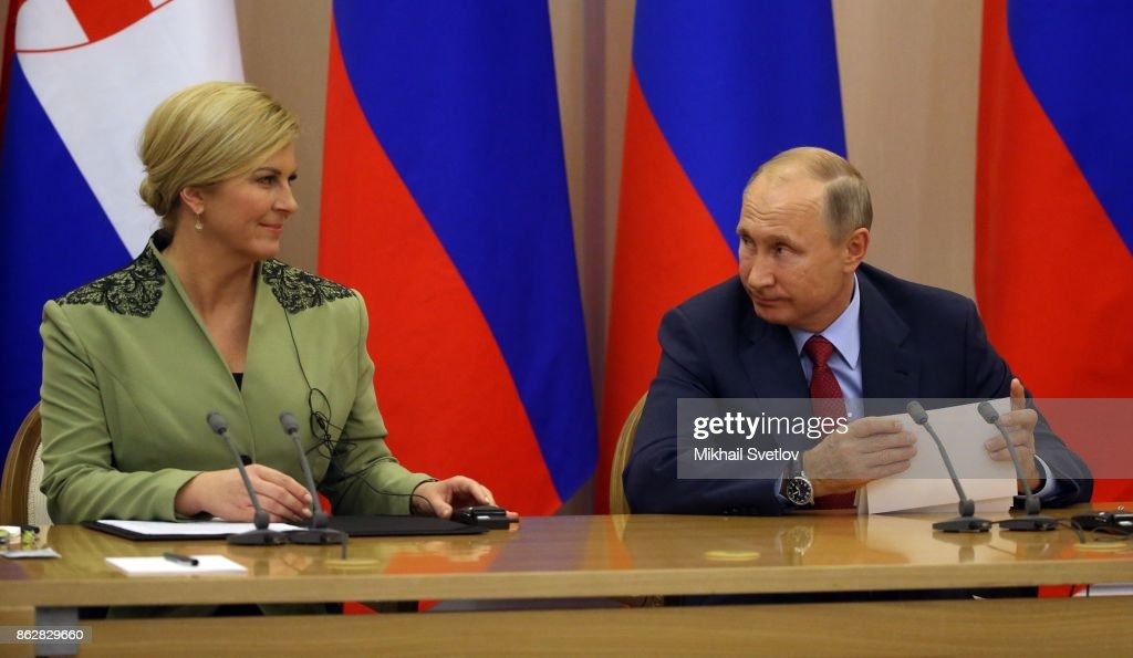 Russian President Vladimir Putin (R) looks on Croatian President Kolinda Grabar-Kitarovic (L) during their meeting on October 18, 2017 in Sochi, Russia.