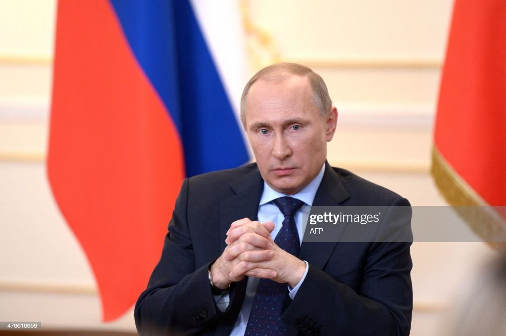 Russian President <a gi-track='captionPersonalityLinkClicked' href=/galleries/search?phrase=Vladimir+Putin&family=editorial&specificpeople=154896 ng-click='$event.stopPropagation()'>Vladimir Putin</a> looks on during a press conference in his country residence of Novo-Ogaryova outside Moscow on March 4, 2014. Russian President <a gi-track='captionPersonalityLinkClicked' href=/galleries/search?phrase=Vladimir+Putin&family=editorial&specificpeople=154896 ng-click='$event.stopPropagation()'>Vladimir Putin</a> on March 4 said that deposed Ukrainian president Viktor Yanukovych had no political future but asserted he was legally still head of state. AFP PHOTO / RIA NOVOSTI PRESIDENTIAL PRESS SERVICE - POOL / ALEXEY NIKOLSKY