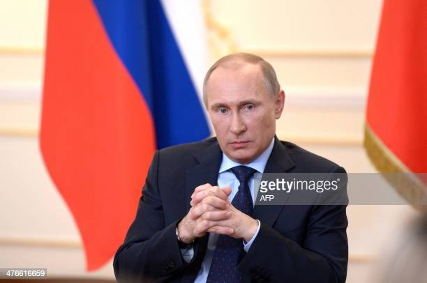 Russian President Vladimir Putin looks on during a press conference in his country residence of NovoOgaryova outside Moscow on March 4 2014 Russian...