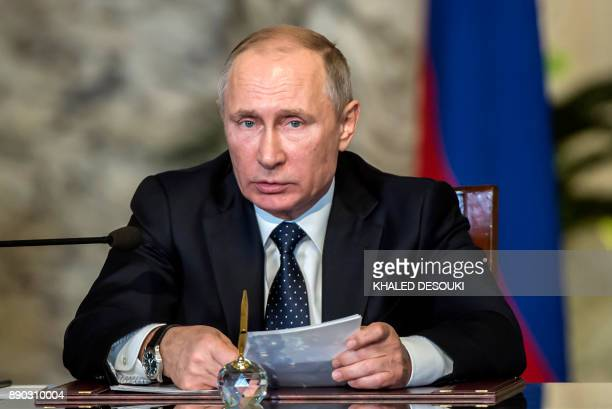 Russian President Vladimir Putin looks on during a press conference with his Egyptian counterpart following their talks at the presidential palace in...