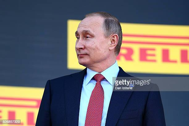 Russian President Vladimir Putin looks on from the podium after the Formula One Grand Prix of Russia at Sochi Autodrom on May 1 2016 in Sochi Russia