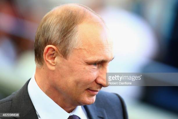 Russian President Vladimir Putin looks on prior to the 2014 FIFA World Cup Brazil Final match between Germany and Argentina at Maracana on July 13...