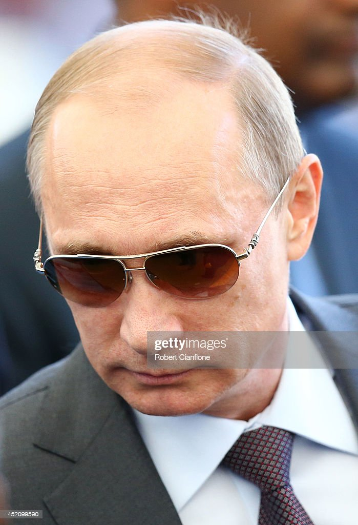 Russian President <a gi-track='captionPersonalityLinkClicked' href=/galleries/search?phrase=Vladimir+Putin&family=editorial&specificpeople=154896 ng-click='$event.stopPropagation()'>Vladimir Putin</a> looks on prior to the 2014 FIFA World Cup Brazil Final match between Germany and Argentina at Maracana on July 13, 2014 in Rio de Janeiro, Brazil.