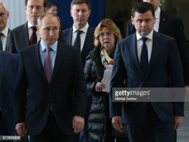 Russian President Vladimir Putin looks on Yaroslavl oblast region Governor Dmitry Mironov while visiting the NPO Saturn in Rybinsk Russia April 2017...