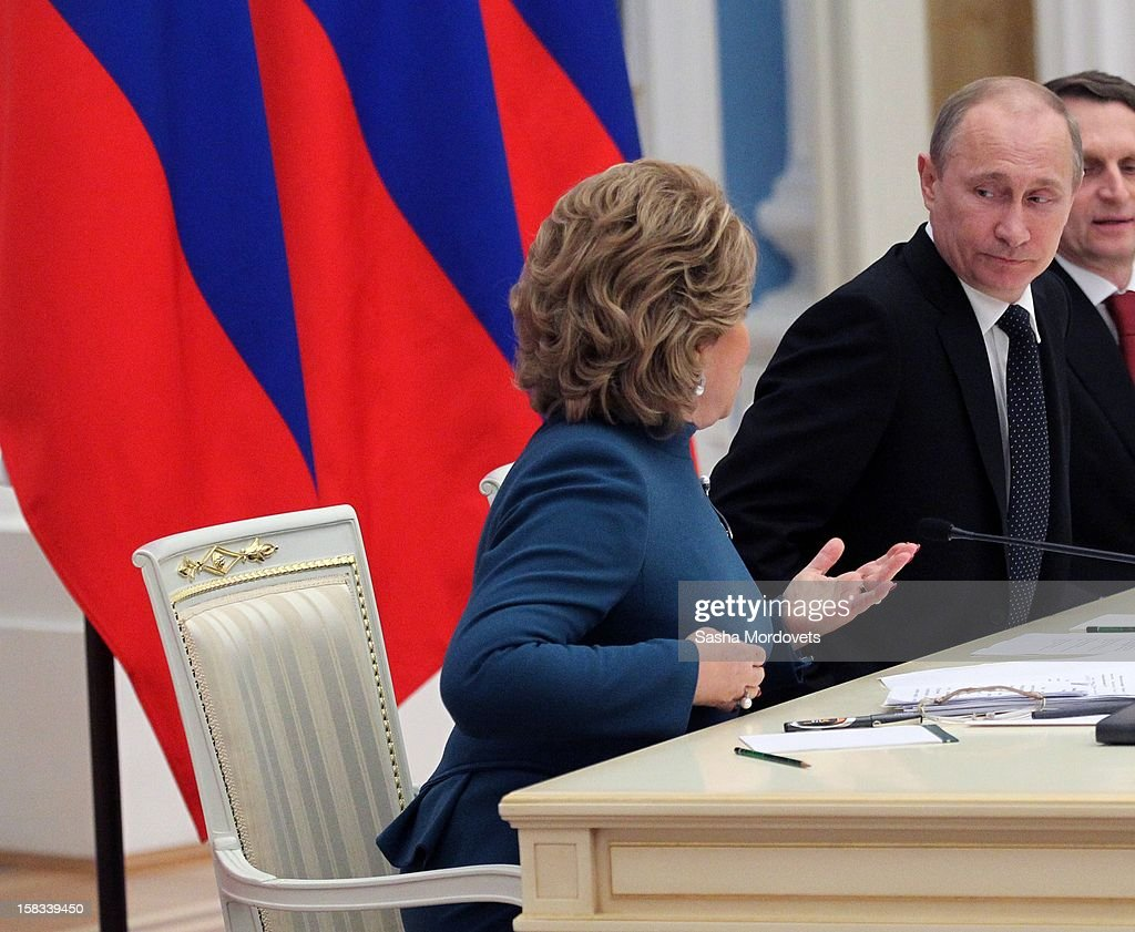 Russian President <a gi-track='captionPersonalityLinkClicked' href=/galleries/search?phrase=Vladimir+Putin&family=editorial&specificpeople=154896 ng-click='$event.stopPropagation()'>Vladimir Putin</a> (2nd R) looks to Speaker of the Council of Federation Valentina Matviyenko (L) during a meeting of lawmakers in the Kremlin December 13, 2012 in Moscow, Russia. Putin has described as 'unfriendly' a U.S. bill that imposes sanctions on Russian officials accused of human rights violations.