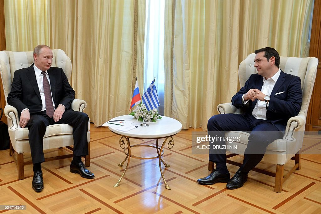 Russian President Vladimir Putin (L) meets Greek Prime Minister Alexis Tsipras during a meeting in Athens, on May 27, 2016. Russian President Vladimir Putin was in Greece on May 27 in a visit aimed at reinforcing a relationship with one of his few friends in the EU amid tensions with the West. The visit, Putin's first to the EU since December, comes at a low ebb in relations between Russia and Europe over the conflict in Ukraine that broke out in 2014, with sanctions still in force against Moscow. / AFP / SPUTNIK / Alexei Druzhinin