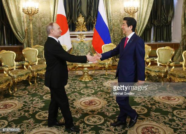 Russian President Vladimir Putin meets Japanese Prime Minister Shinzo Abe during talks at the Grand Kremlin Palace on April 2017 in Moscow Russia...