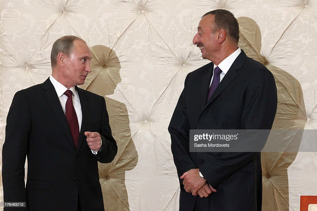 Russian President <a gi-track='captionPersonalityLinkClicked' href=/galleries/search?phrase=Vladimir+Putin&family=editorial&specificpeople=154896 ng-click='$event.stopPropagation()'>Vladimir Putin</a> (L) meets with Azerbaijani President <a gi-track='captionPersonalityLinkClicked' href=/galleries/search?phrase=Ilham+Aliyev&family=editorial&specificpeople=565601 ng-click='$event.stopPropagation()'>Ilham Aliyev</a> August 13, 2013 in Baku, Azerbaijan. Putin is in Azerbaijan for a one-day state visit.