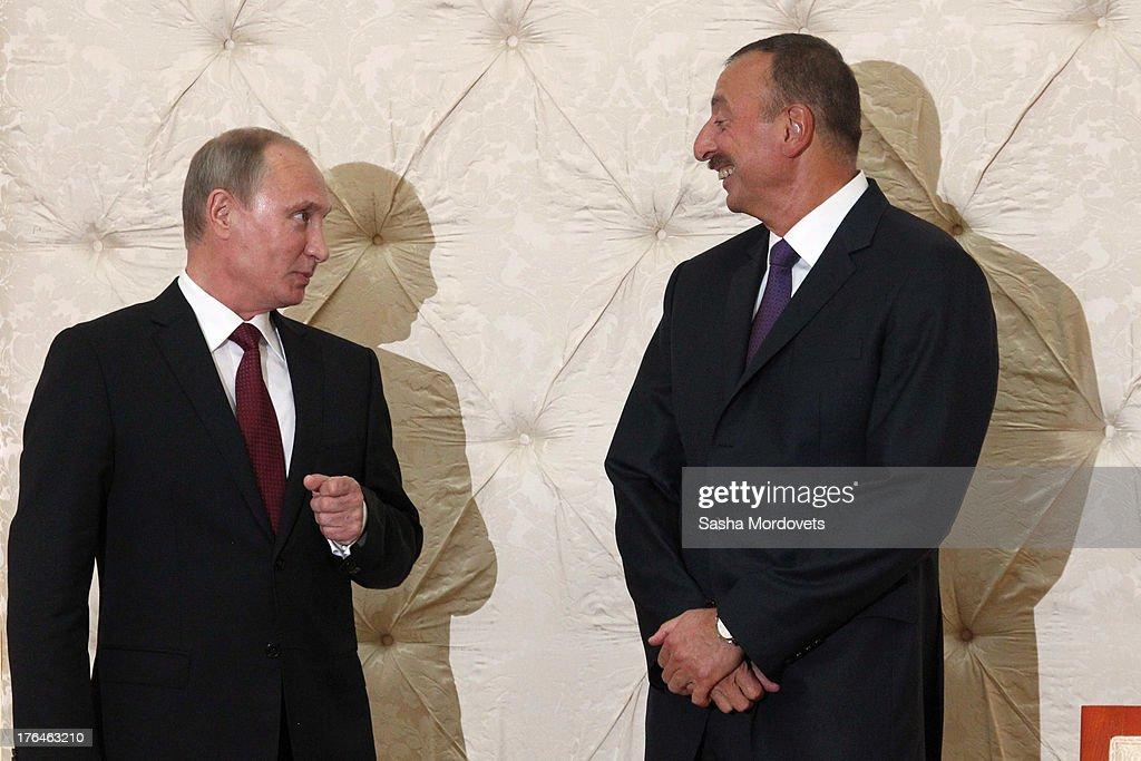 Russian President Vladimir Putin (L) meets with Azerbaijani President Ilham Aliyev August 13, 2013 in Baku, Azerbaijan. Putin is in Azerbaijan for a one-day state visit.