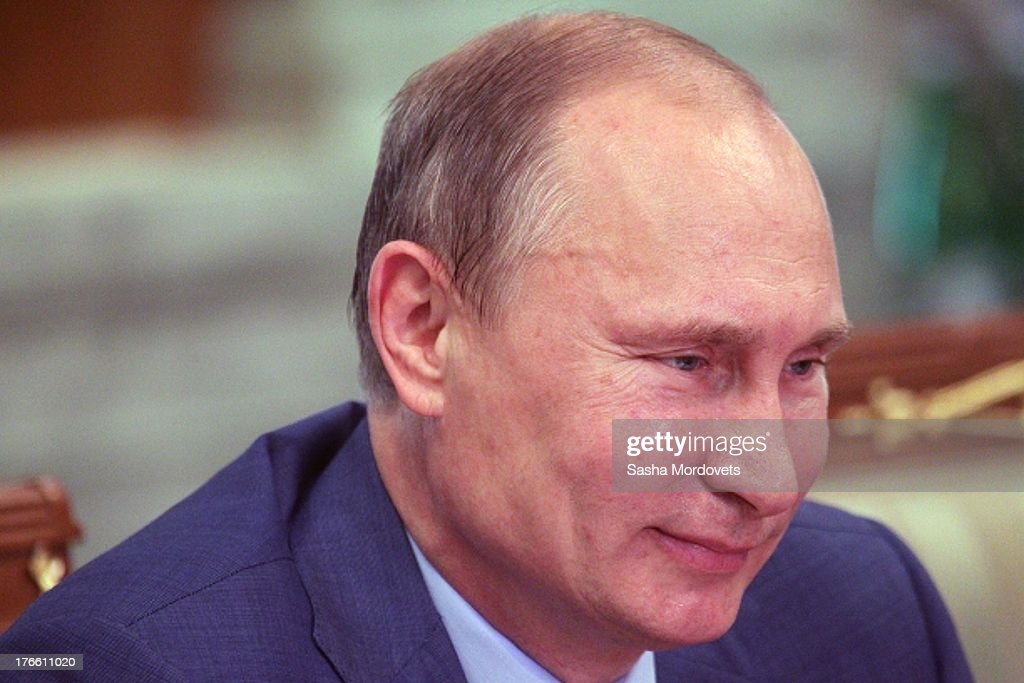 Russian President <a gi-track='captionPersonalityLinkClicked' href=/galleries/search?phrase=Vladimir+Putin&family=editorial&specificpeople=154896 ng-click='$event.stopPropagation()'>Vladimir Putin</a> meets with China's State Council Jang Jiechi on August 16, 2013 in Sochi, Russia. Jeichi has arrived to Putin's Black Sea resort residence for negotiations.