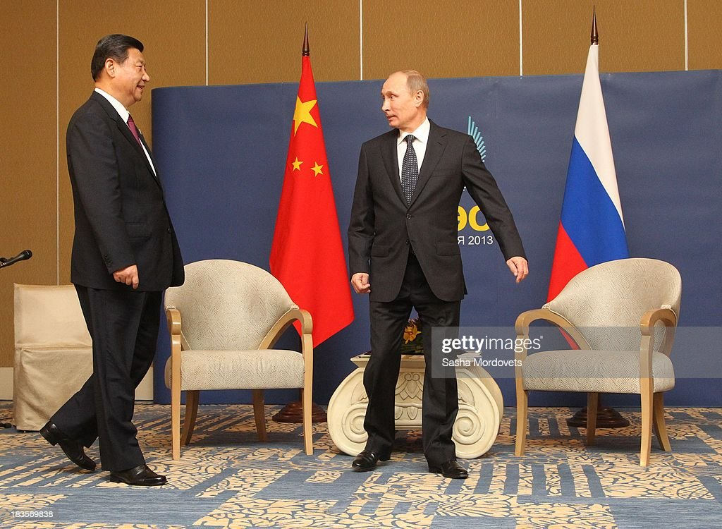 Russian President <a gi-track='captionPersonalityLinkClicked' href=/galleries/search?phrase=Vladimir+Putin&family=editorial&specificpeople=154896 ng-click='$event.stopPropagation()'>Vladimir Putin</a> (R) meets with Chinese President <a gi-track='captionPersonalityLinkClicked' href=/galleries/search?phrase=Xi+Jinping&family=editorial&specificpeople=2598986 ng-click='$event.stopPropagation()'>Xi Jinping</a> (L) at the APEC Leaders Summit on October 7, 2013 in Denpadsar, Bali, Indonesia. US President Barack Obama will not be attending the annual gathering due to the US government shutdown, seen as potentially weakening the United States attempts to push for an ambitious 12 nation trade pact.
