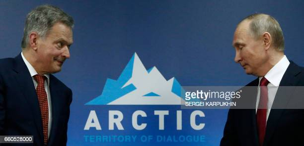 Russian President Vladimir Putin meets with Finnish President Sauli Niinisto during the International Arctic Forum in Arkhangelsk on March 30 2017 /...