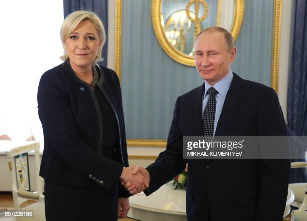 TOPSHOT Russian President Vladimir Putin meets with French presidential election candidate for the farright Front National party Marine Le Pen at the...