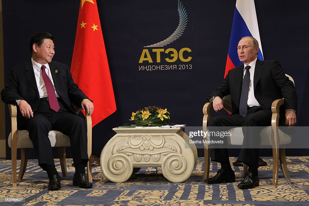 Russian President <a gi-track='captionPersonalityLinkClicked' href=/galleries/search?phrase=Vladimir+Putin&family=editorial&specificpeople=154896 ng-click='$event.stopPropagation()'>Vladimir Putin</a> (R) meets with hinese President <a gi-track='captionPersonalityLinkClicked' href=/galleries/search?phrase=Xi+Jinping&family=editorial&specificpeople=2598986 ng-click='$event.stopPropagation()'>Xi Jinping</a> (L) at the APEC Leaders Summit on October 7, 2013 in Denpadsar, Bali, Indonesia. US President Barack Obama will not be attending the annual gathering due to the US government shutdown, seen as potentially weakening the United States attempts to push for an ambitious 12 nation trade pact.