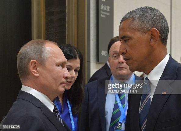 TOPSHOT Russian President Vladimir Putin meets with his US counterpart Barack Obama on the sidelines of the G20 Leaders Summit in Hangzhou on...