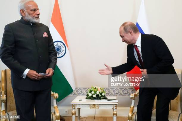 Russian President Vladimir Putin meets with Indian Prime Minister Narendra Modi on the sidelines of the St Petersburg International Economic Forum in...